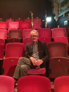 Paul Lewis of Seven Experience marketing consultancy sitting in a seat at Theatre Royal Winchester